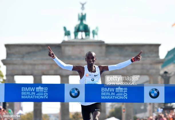Kenya's Eliud Kipchoge crosses the finish line to win the Berlin Marathon setting a new world record on September 16 2018 in Berlin