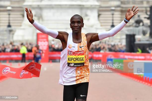 Kenya's Eliud Kipchoge crosses the finish line to win the elite men's race of the 2019 London Marathon in central London on April 28 2019 Kenya's...