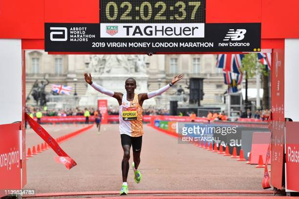 TOPSHOT Kenya's Eliud Kipchoge crosses the finish line to win the elite men's race of the 2019 London Marathon in central London on April 28 2019...