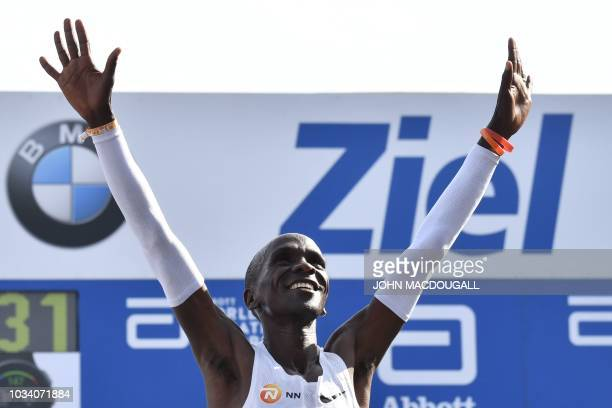 Kenya's Eliud Kipchoge reacts after winning the Berlin Marathon setting a new world record on September 16 2018 in Berlin
