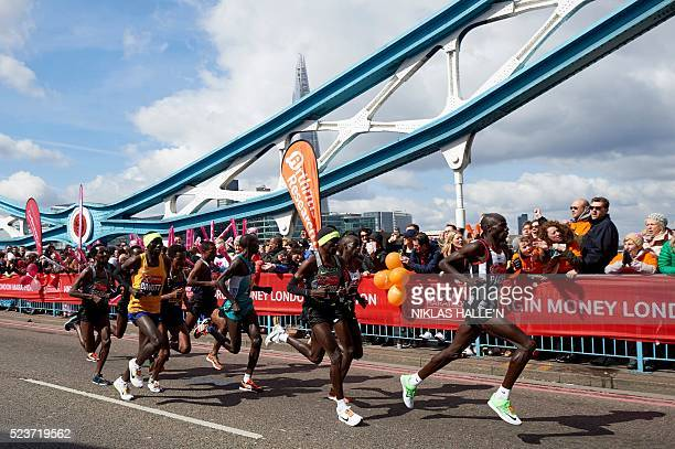 Kenya's Eliud Kipchoge runs behind a pacemaker at the head of the elite men's race of the 2016 London Marathon in central London on April 24 2016...