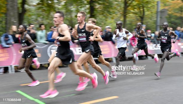 Kenya's Eliud Kipchoge runs during his attempt to bust the mythical two-hour barrier for the marathon on October 12 2019 in Vienna. - Kipchoge holds...