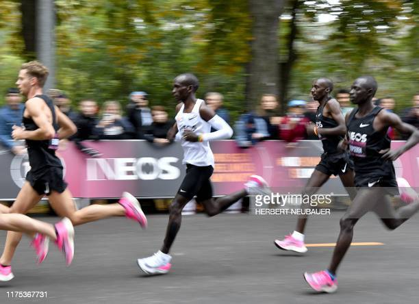 Kenya's Eliud Kipchoge runs during his attempt to bust the mythical twohour barrier for the marathon on October 12 2019 in Vienna Kipchoge holds the...