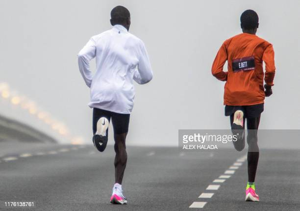 Kenya's Eliud Kipchoge warms up at the Reichsbrücke before his attempt to bust the mythical twohour barrier for the marathon on October 12 2019 in...