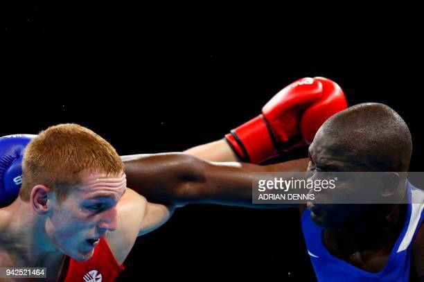 Kenya's Elly Ochola fights against Scotland's Scott Forrest during the mens heavy category preliminary boxing match during the 2018 Gold Coast...