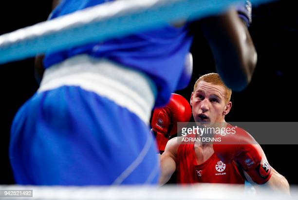Kenya's Elly Ochola fights Scotland's Scott Forrest during the mens heavy category preliminary boxing match during the 2018 Gold Coast Commonwealth...