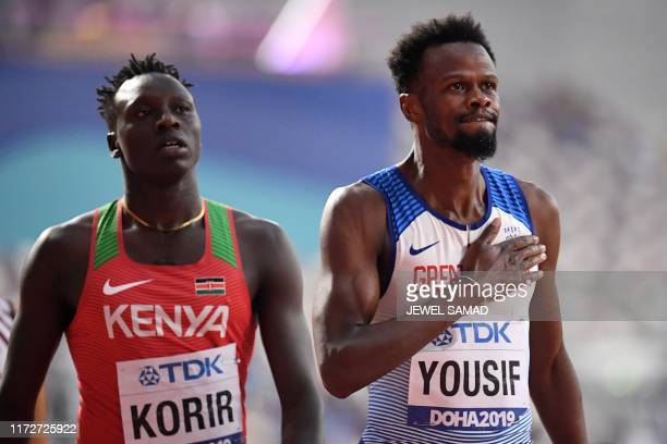 Kenya's Emmanuel Kipkurui Korir and Britain's Rabah Yousif react after the Men's 400m heats at the 2019 IAAF Athletics World Championships at the...