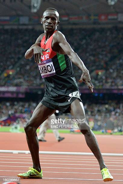 Kenya's Ezekiel Kemboi celebrates after the men's 3000m steeplechase final at the athletics event during the London 2012 Olympic Games on August 5,...