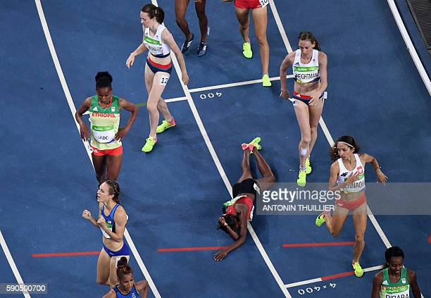 TOPSHOT Kenya's Faith Chepngetich Kipyegon celebrates after she won the Women's 1500m Final during the athletics event at the Rio 2016 Olympic Games...