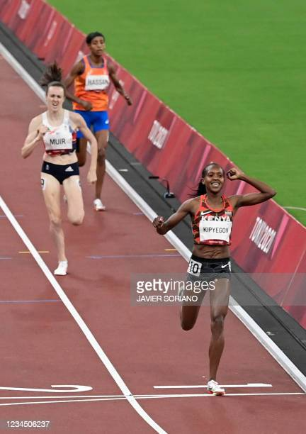 Kenya's Faith Kipyegon crosses the finish line to win ahead of Britain's Laura Muir and Netherlands' Sifan Hassan in the women's 1500m final during...