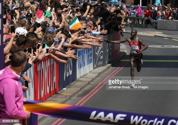 Kenya's Geoffrey Kipkorir Kirui high fives spectators as he approaches the finish line in the Men's Marathon during day three of the 2017 IAAF World...