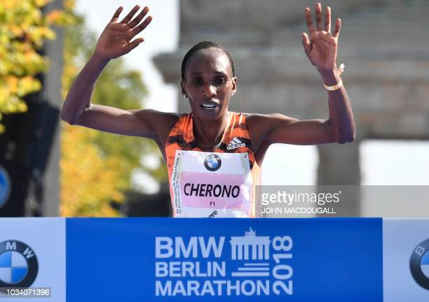 Kenya's Gladys Cherono crosses the finish line to win the women's category of the Berlin Marathon on September 16 2018 in Berlin