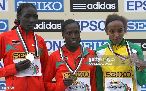 Kenya's gold medallist Florence Kiplagat her silver medallist compatriot Linet Masai and Ethiopia's bronze medallist Meselech Melkamu stand on the...