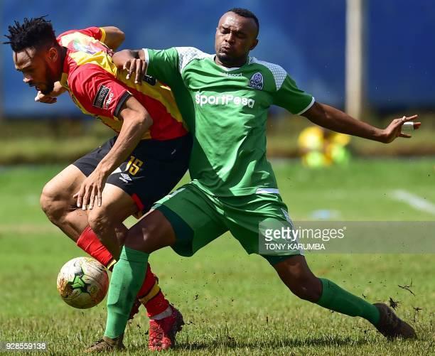 Kenya's Gor Mahia Jacques Tuyisenge tackles Tunisia's Esperance sportive de Tunis Ivorian midfielder Fousseny Coulibaly during their Confederation of...