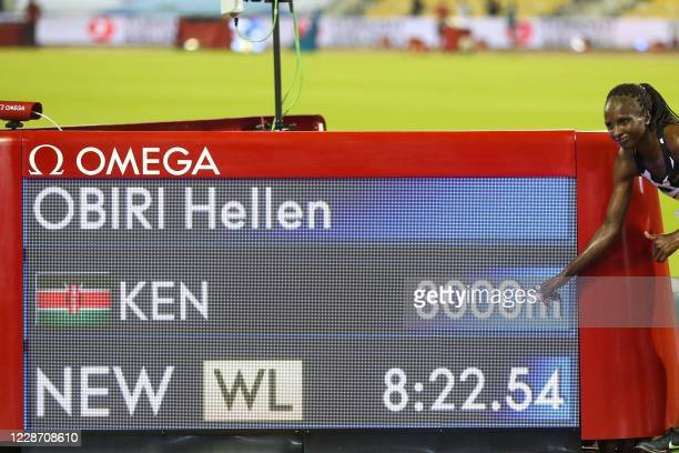 Kenya's Hellen Obiri celebrates after setting the new World Lead time in the women's 3000m during the IAAF Diamond League competition on September...
