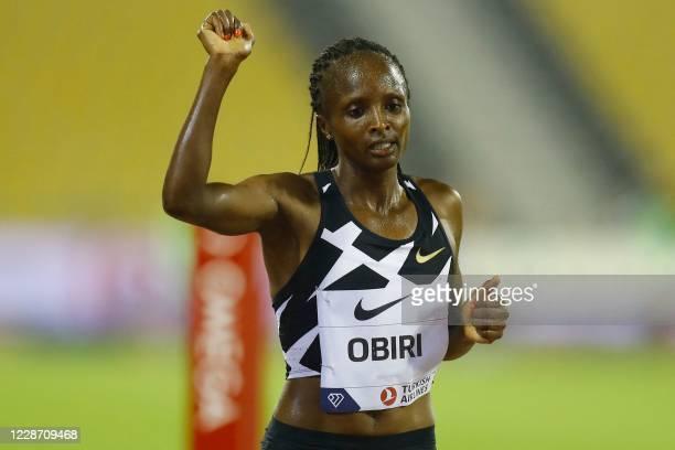 Kenya's Hellen Obiri celebrates after winning the Women's 3000m during the IAAF Diamond League competition on September 25, 2020 at the Suheim Bin...