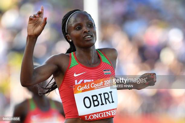 Kenyas Hellen Obiri crosses the finish line to win the athletics women's 5000m final during the 2018 Gold Coast Commonwealth Games at the Carrara...
