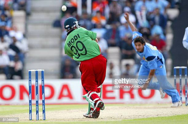 Kenya's Hitesh Modi hits out only to be caught by India's captain Sourav Ganguly off the bowling of Irfan Pathan in the ICC Champions Trophy match at...