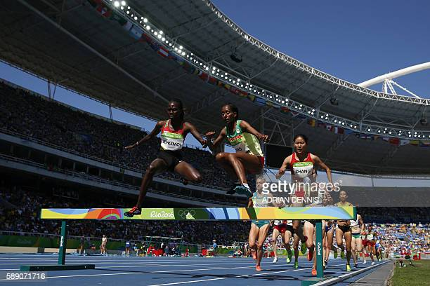 TOPSHOT Kenya's Hyvin Jepkemoi Ethiopia's Etenesh Diro and China's Zhang Xinyan compete in the Women's 3000m Steeplechase Round 1 during the...