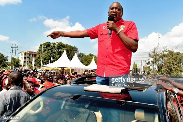 Kenya's incumbent President Uhuru Kenyatta addresses supporters during his campaign tour seeking for a reelection at Changamwe constituency Mombasa...