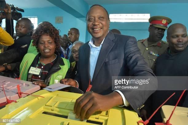 Kenya's incumbent President Uhuru Kenyatta votes at the polling station during the August 8 2017 presidential election in Gatundu Kiambu county...