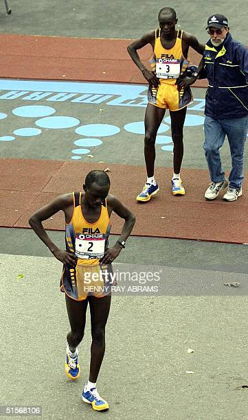 Kenya's Japhet Kosgei the second place men's finisher in the New York City Marathon walks away from the finish line along with Kenya's Shem Kororia...