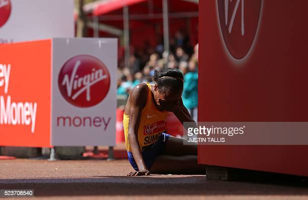 Kenya's Jemima Sumgong is pictured after winning the Elite Women's race of the 2016 London Marathon in central London on April 24 2016 / AFP / JUSTIN...