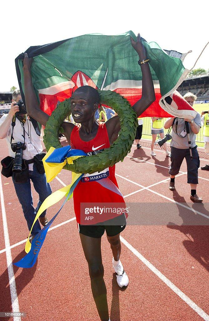 Kenya's Joseph Langat (C) celebrates after winning the marathon at the Olympic Stadium in Stockholm on June 5, 2010. Langat won in a time of 2.12:48. AFP PHOTO/SCANPIX/Fredrik Sandberg