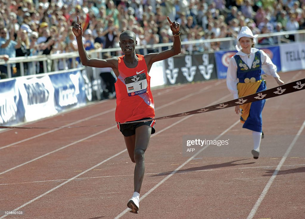Kenya's Joseph Langat (C) celebrates after winning the marathon at the Olympic Stadium in Stockholm on June 5, 2010. Langat won in a time of 2.12:48. AFP PHOTO/SCANPIX/Fredrik Sandberg