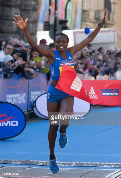 Kenya's Joyciline Jepkosgei crosses the finnish line to win the International Half Marathon on April 1 2017 in Prague Kenya's Joyciline Jepkosgei...