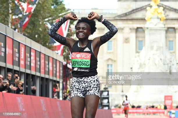 Kenya's Joyciline Jepkosgei crosses the line to win the women's race of the 2021 London Marathon in central London on October 3, 2021. - - Restricted...