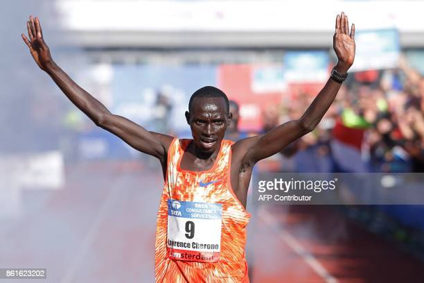 Kenya's Lawrence Cherono gestures as he crosses the finish line to win the Amsterdam Marathon on October 15, 2017. Cherono finished the race in...