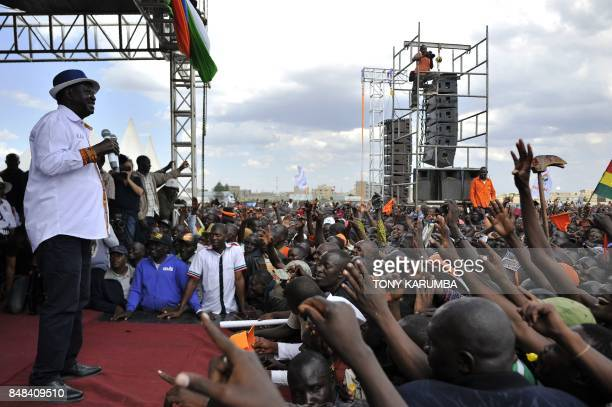Kenya's main political opposition National Super Alliance presidential flagbearer Raila Odinga speaks as supporters cheer during a political rally on...