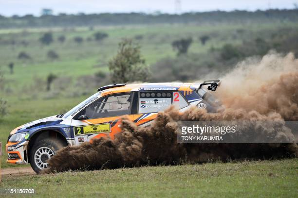 Kenyas Manvir Baryan and his British navigator Drew Sturrock kick up a dust cloud in the Skoda Fabia R5 as they negotiate a turn on July 6 during the...