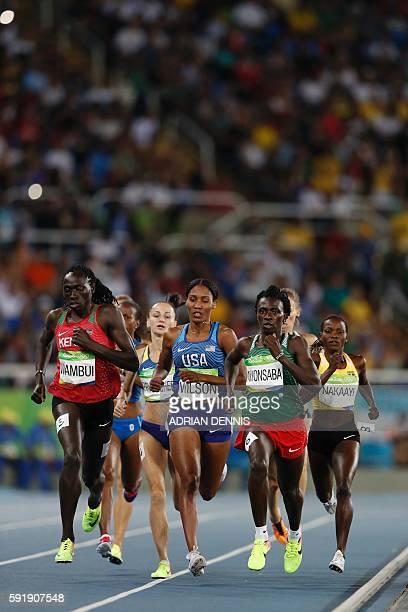 Kenya's Margaret Nyairera Wambui USA's Ajee Wilson and Burundi's Francine Niyonsaba compete in the Women's 800m Semifinal during the athletics event...
