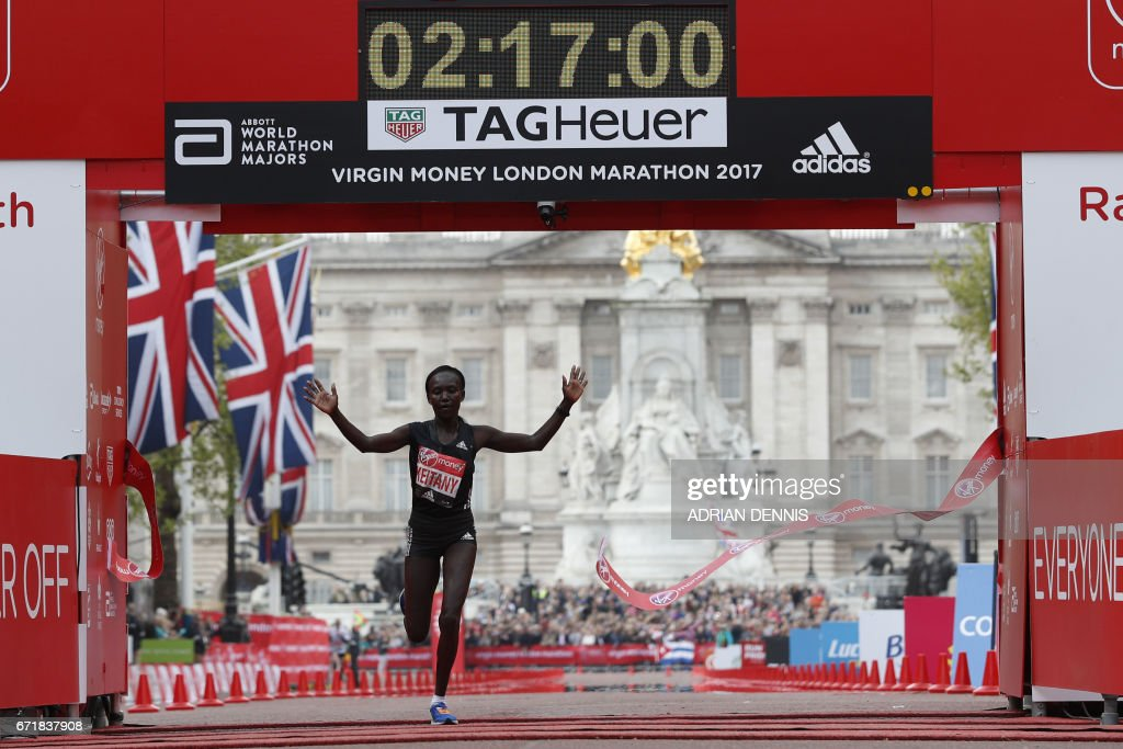 Kenya's Mary Keitany wins the women's elite race at the London marathon on April 23, 2017 in London. Kenya's Mary Keitany won a third London Marathon today posting an unofficial time of 2hrs 17min 01sec -- the fastest time in a women-only marathon. / AFP PHOTO / Adrian DENNIS