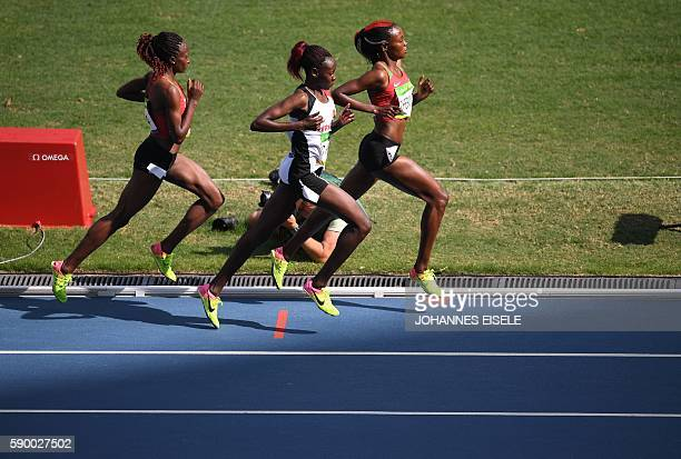 Kenya's Mercy Cherono and Turkey's Yasemin Can compete in the Women's 5000m Round 1 during the athletics event at the Rio 2016 Olympic Games at the...