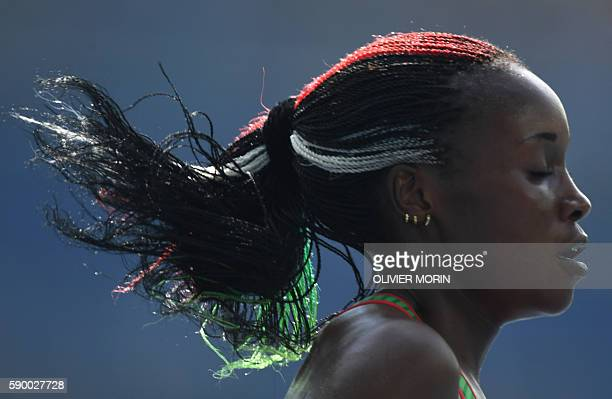 Kenya's Mercy Cherono competes in the Women's 5000m Round 1 during the athletics event at the Rio 2016 Olympic Games at the Olympic Stadium in Rio de...