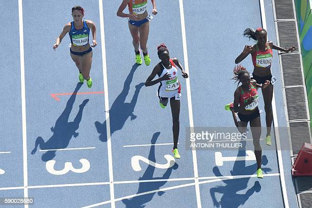 Kenya's Mercy Cherono, Kenya's Helen Obiri, Turkey's Yasemin Can and USA's Shelby Houlihan compete in the Women's 5000m Round 1 during the athletics...