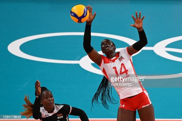 Kenya's Mercy Moim hits a shot in the women's preliminary round pool A volleyball match between Japan and Kenya during the Tokyo 2020 Olympic Games...