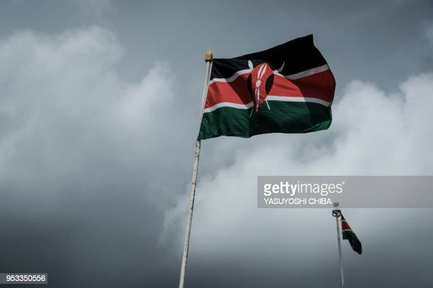 Kenya's national flag flies in the wind during the Labour Day Parade organized by the Central Organization of Trade Unions Kenya at Uhuru Park in...