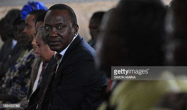 Kenya's newly elected President Uhuru Kenyatta attends a mass on March 10 2013at the Martyrs of Uganda Catholic church during a thanksgiving service...
