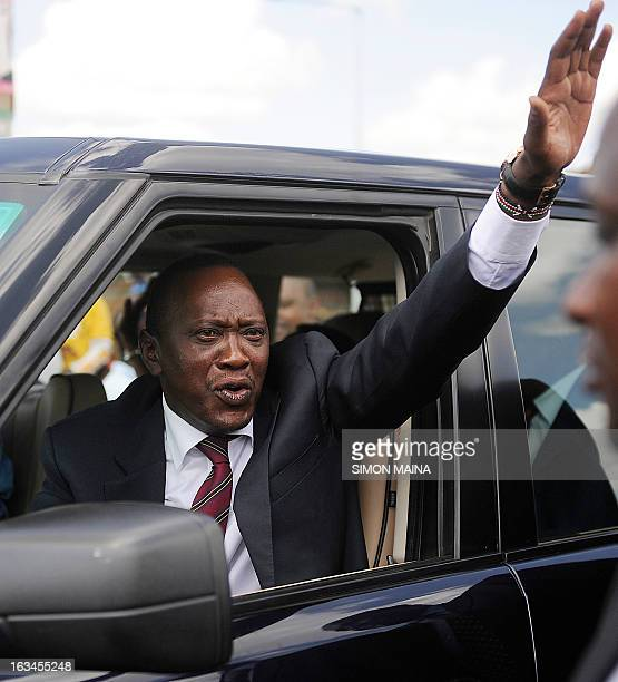 Kenya's newly elected President Uhuru Kenyatta waves to faithfuls after attending a mass on March 10 2013 at the Martyrs of Uganda Catholic church...