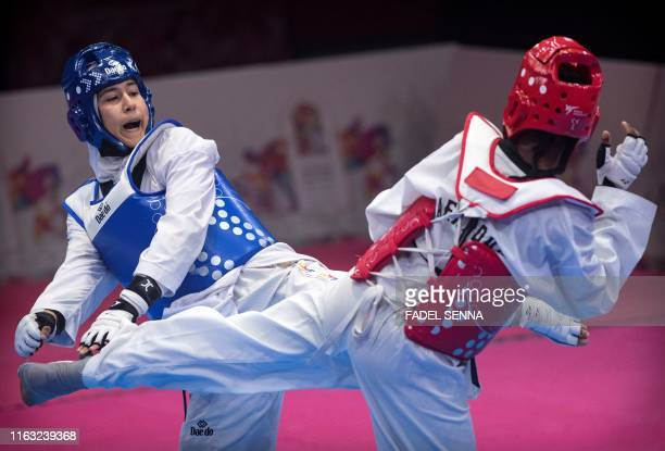 Kenya's Ogallo Faith Wanjiku and Morocco's Aboufaras Fatima ezzahra compete in the Taekwondo men's 58kg 63 kg final during the 12th edition of the...