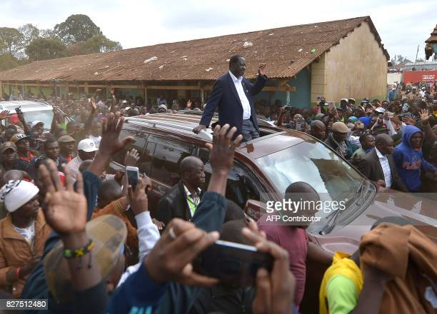 Kenya's opposition alliance National Super Alliance presidential candidte Raila Odinga arrives at OldKibera primary school polling centre to cast his...