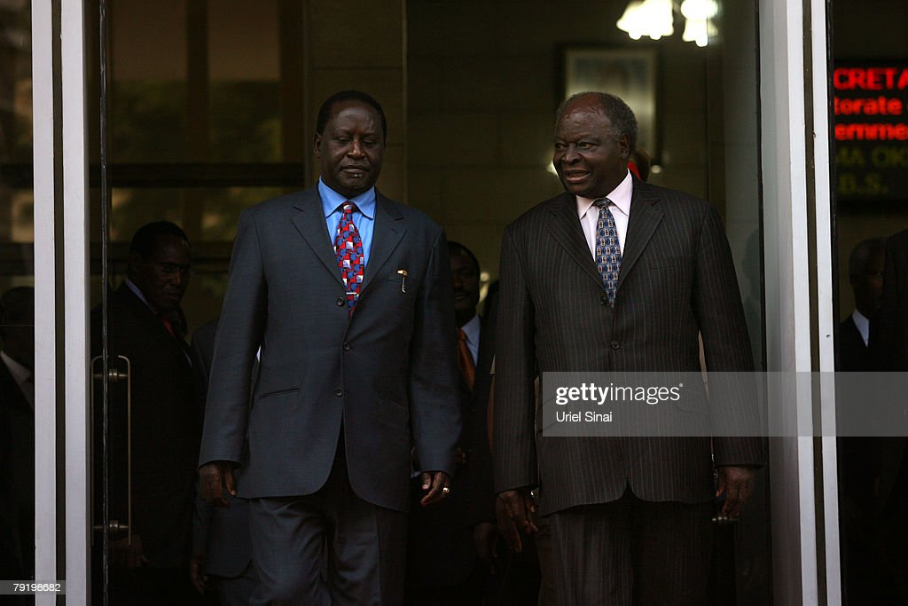 Kenya's opposition leader Raila Odinga (R) and Kenyan President Mwai Kibaki arrive for a press conference outside the president's office on January 24, 2008 in Nairobi, Kenya. The meeting between the two rivals is the first since the disputed presidential election that led to bloodshed across the country.