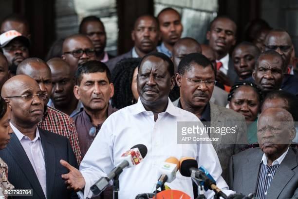 Kenya's opposition leader Raila Odinga of the opposition National Super Alliance coalition addresses media representatives in Nairobi on October 18...