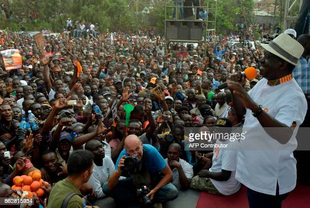 Kenya's opposition leader Raila Odinga of the opposition National Super Alliance coalition gestures as he addresses supporters at a political rally...