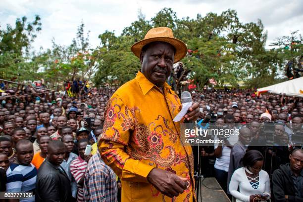 Kenya's opposition leader Raila Odinga of the opposition National Super Alliance coalition delivers a speech during the funeral service for three...