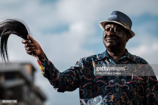 Kenya's opposition leader Raila Odinga of the opposition National Super Alliance coalition gestures to supporters during a political rally in...